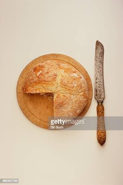 Bread , cutting board and knife