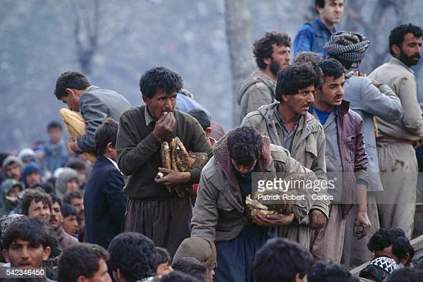 Bread distribution in a refugee camp.