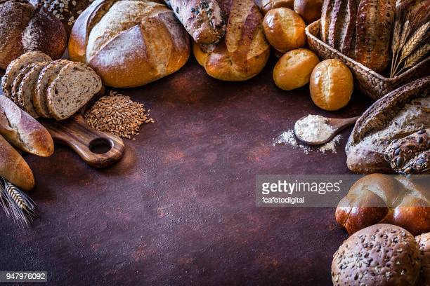 bread frame on rustic table - artisanal food and drink stock pictures, royalty-free photos & images