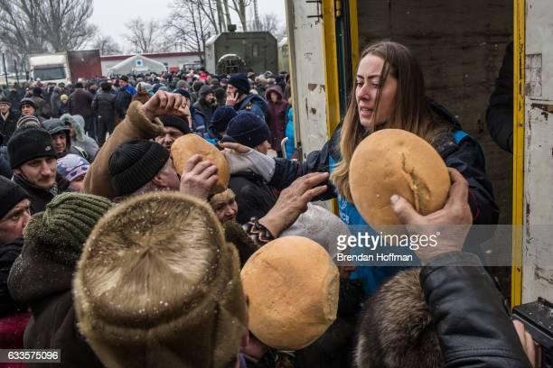 Bread is distributed by workers from the United Nations Refugee Agency at a humanitarian aid distribution point on February 2 2017 in Avdiivka...
