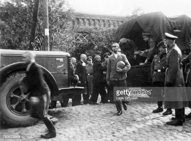Bread is distributed to civilians in Germanoccupied Poland circa 1942 A photo from an album documenting German atrocities in occupied Poland during...