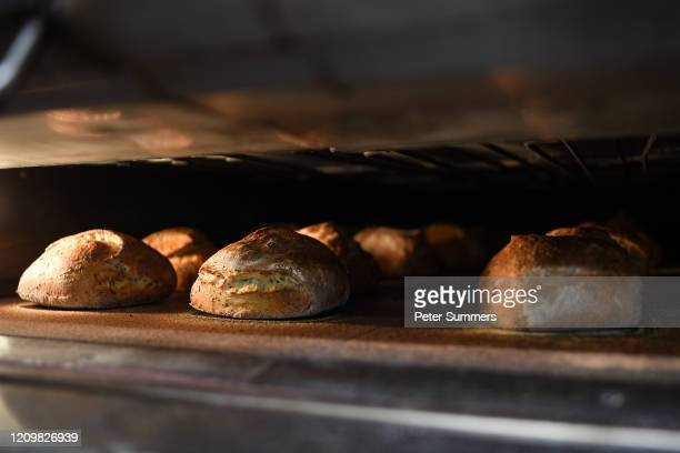 Bread is seen baking in an oven at The Bread Factory on April 14 2020 in London England During the COVID19 outbreak and lockdown the bakeryandcafe...