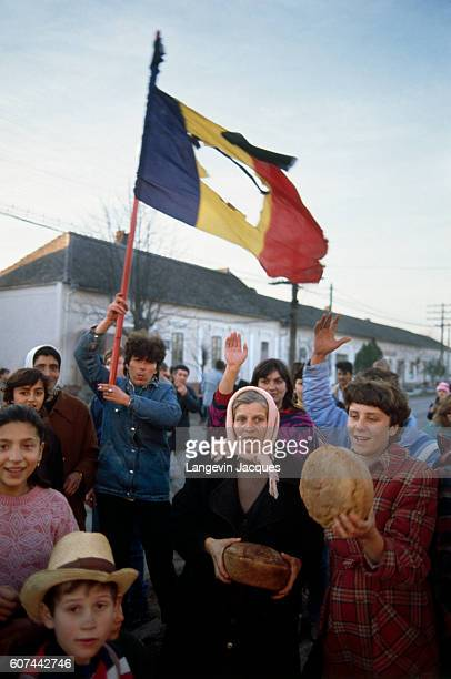 Bread is thrown out to the crowd during insurrection in Timisoara Romania on December 22 1989 Romanian citizens are rising up against Communist...