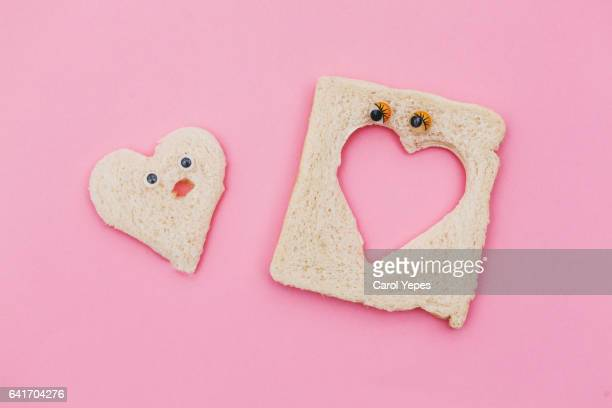 bread love - freaky couples stock photos and pictures