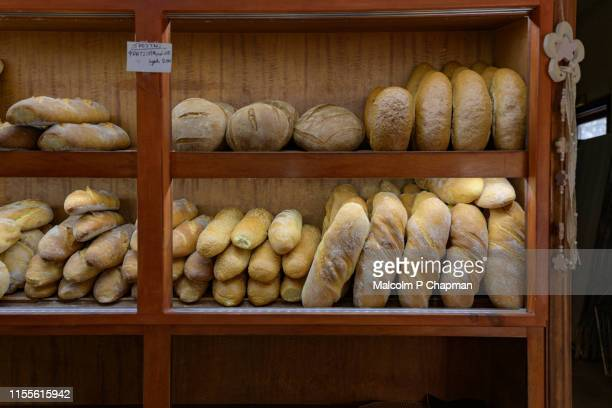 bread on display at greek village bakery, eresos, (eressos), lesvos, greece - greece stock pictures, royalty-free photos & images