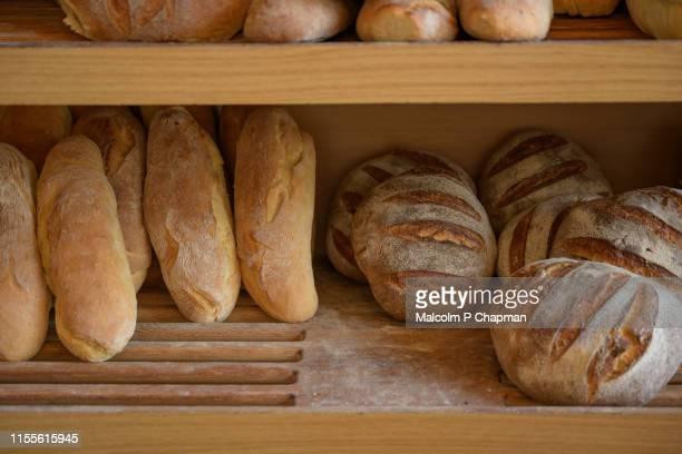 bread on display at greek village bakery, eresos, (eressos), lesvos, greece - lesbos stock pictures, royalty-free photos & images