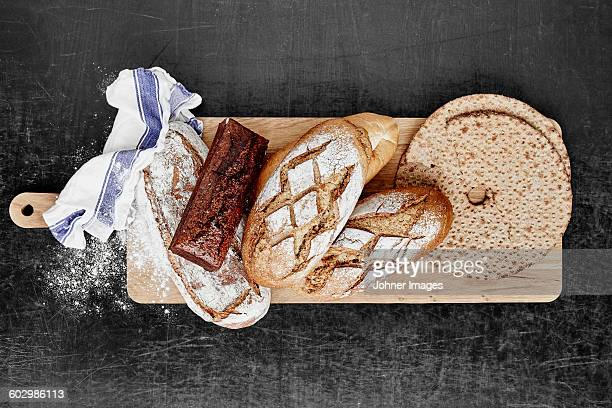 Bread on wooden chopping board