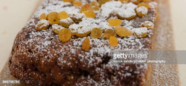 Bread pudding with raisins and icing sugar.