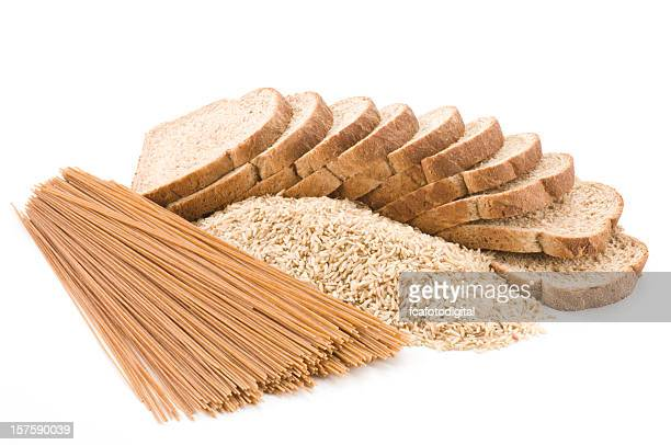 Bread, rice and pasta from whole grains on white backdrop