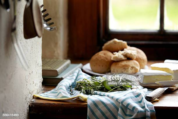 Bread rolls and brie on kitchen counter
