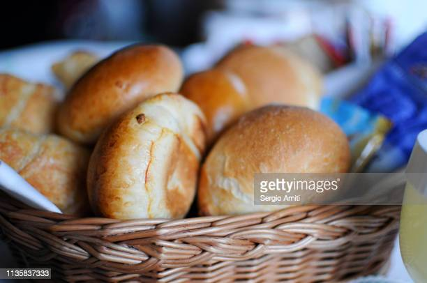 bread rolls in a basket - bun stock pictures, royalty-free photos & images