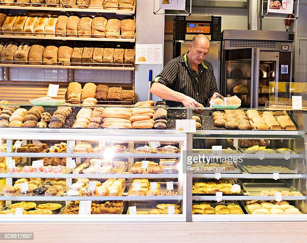 Bread seller places out cakes