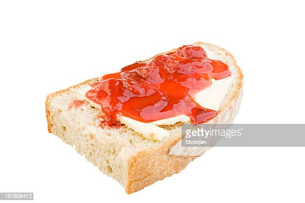 Bread slice with butter and jam