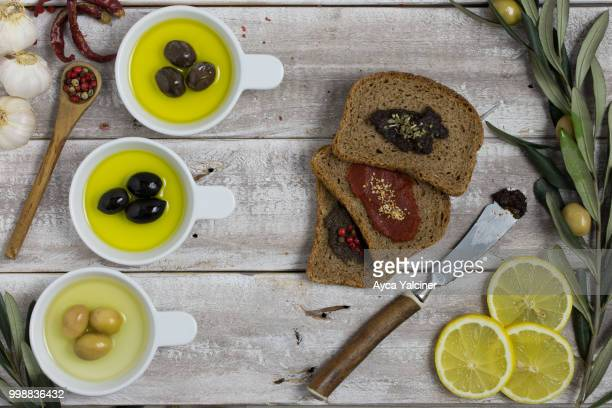Bread slices and olive oil on wood