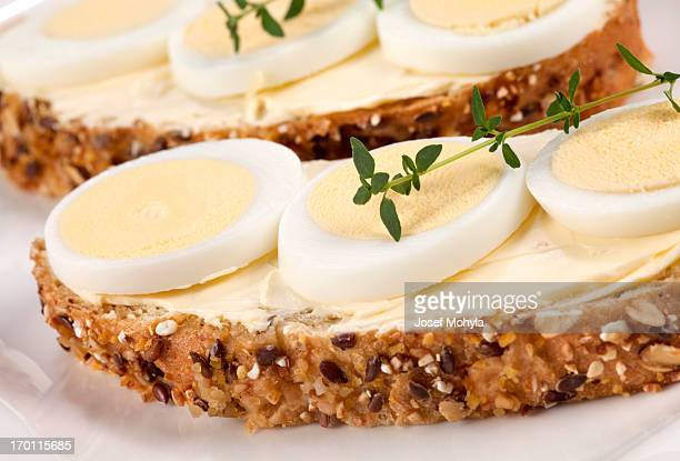 bread with butter and eggs - hard boiled eggs stock photos and pictures