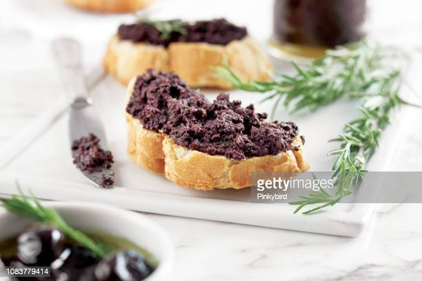 bread with olive pate,olive puree,black olive tapenade, - pureed stock pictures, royalty-free photos & images