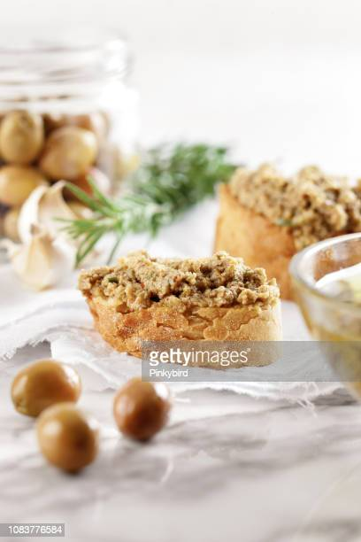 bread with olive pate,olive puree,green olive tapenade, - green olive fruit stock pictures, royalty-free photos & images