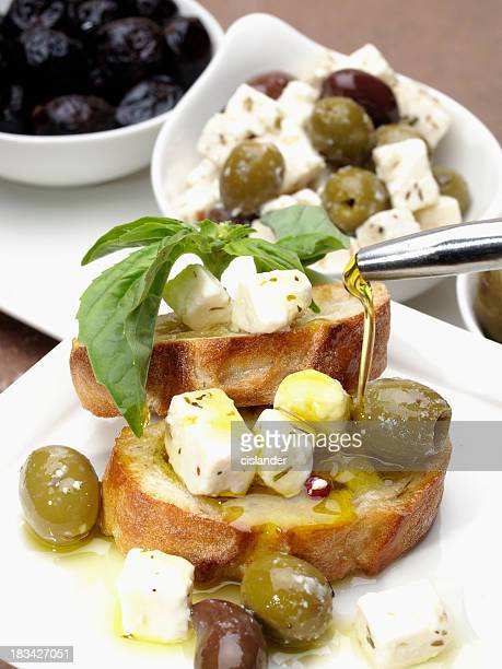 bread with olives, cheese and oil - extra virgin olive oil stock pictures, royalty-free photos & images
