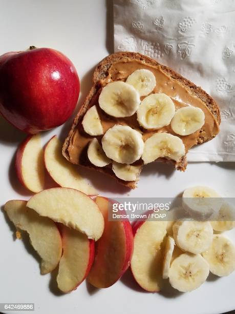 Bread with peanut butter and fruit slices