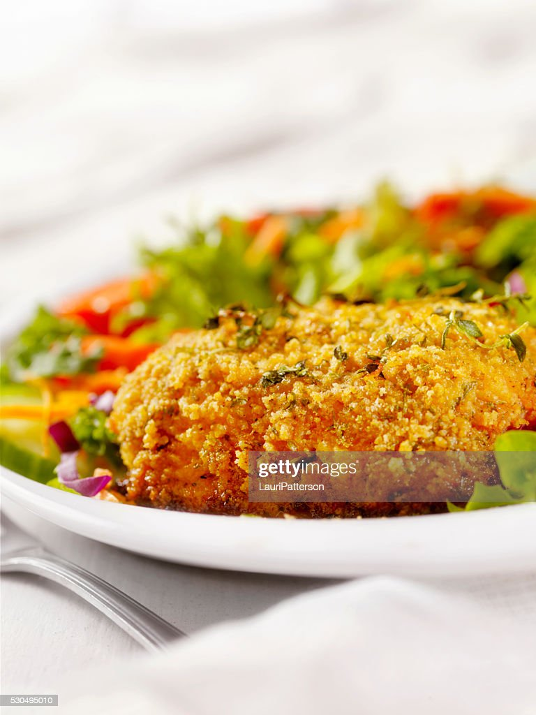 Breaded and Baked Pork Cutlets with a side Salad : Stock Photo