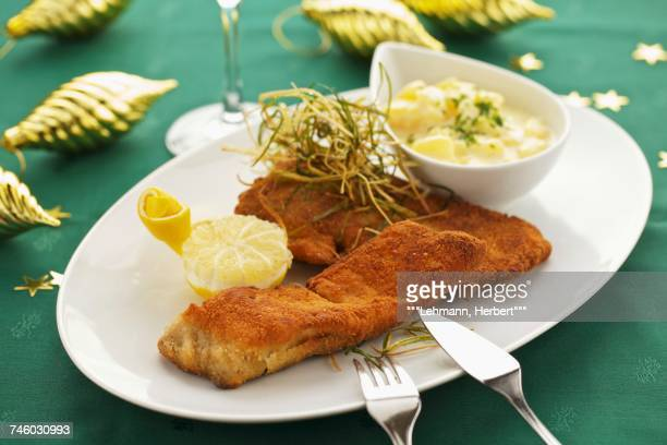 breaded carp fillet with potato salad - carp stock photos and pictures