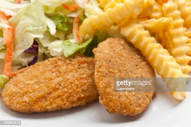 Breaded Chicken Breast, salad, and French Fries