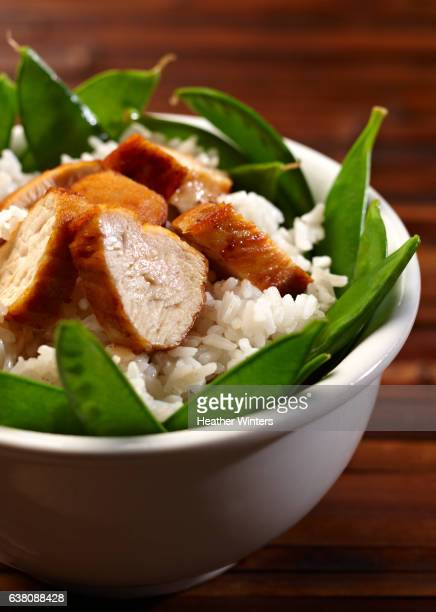 Breaded Chicken with Rice and Snap Peas in Bowl - Close Up