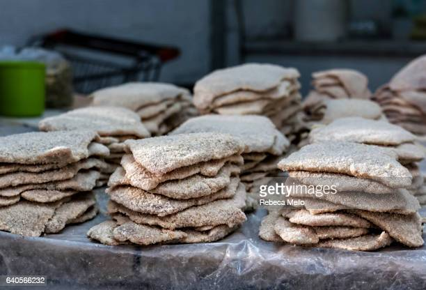 breaded meat  for milanese on display - milanese stock pictures, royalty-free photos & images