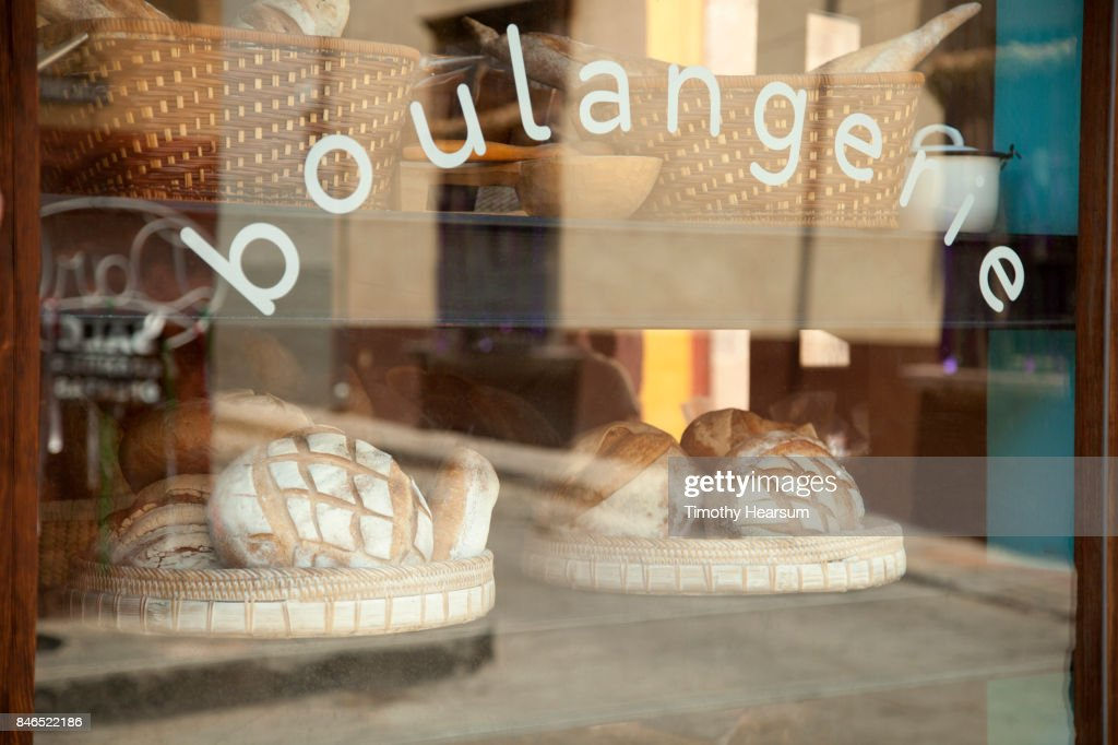 Breads are displayed ad seen through the window of a Mexican bakery : Stock Photo