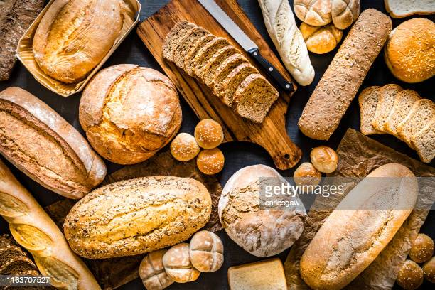 breads assortment background - bread stock pictures, royalty-free photos & images