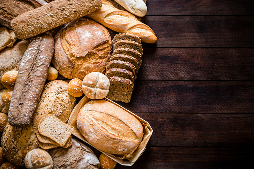 Breads assortment with copy space on rustic wooden table 1163707531