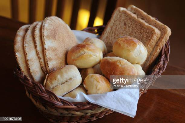 breads in a basket - パン ストックフォトと画像