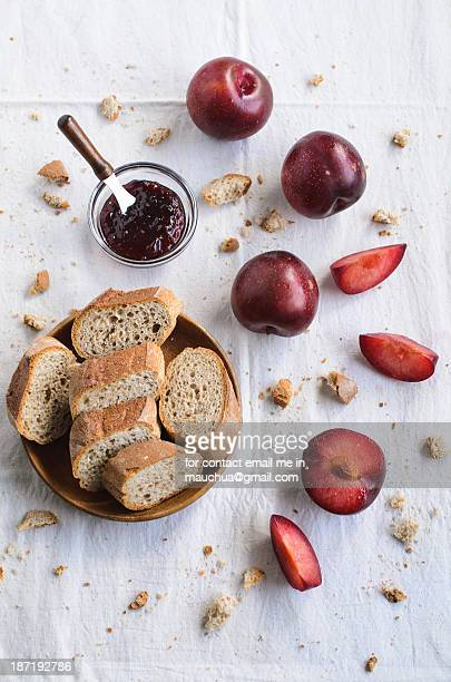 Breads, jams and plums on a sunny morning