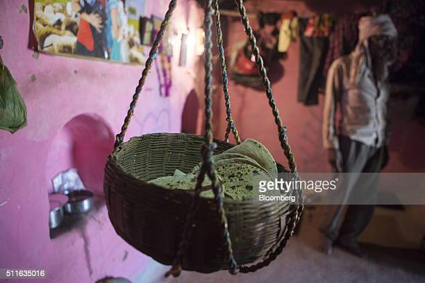 Breads known as 'chapatis' sit in a basket inside the home of farmer Gayadeen Adivasi in the village of Lar Sauryana in Tikamgarh Madhya Pradesh...