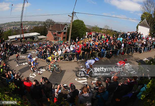 A break away group of riders climb the Mur de Huy during the 79th La Fleche Wallonne from Waremme to Huy on April 22 2015 in Huy Belgium
