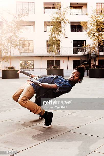 break dancer at courtyard - breakdancing stock photos and pictures
