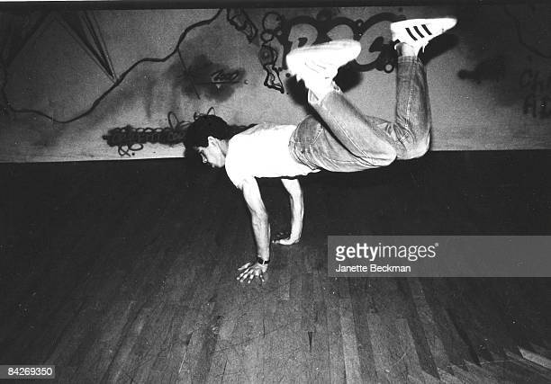 Break dancer, possibly Richard 'Crazy Legs' Colon of the Rock Steady Crew, shows his stuff on a London dance floor, 1982. He is using his hands as a...