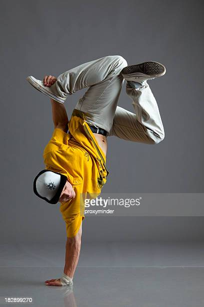 break dancer stand on one arm - breakdancing stock photos and pictures