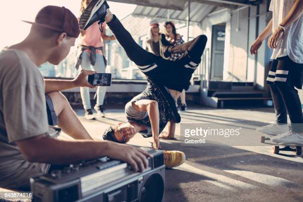 break dancers filming themselves - garage band stock photos and pictures