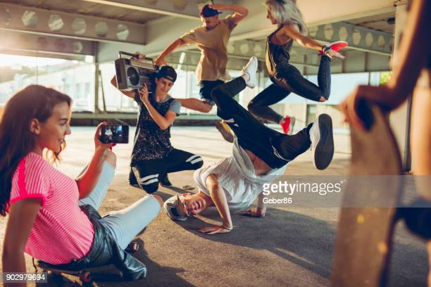 break dancers filming themselves - hip hop music stock pictures, royalty-free photos & images
