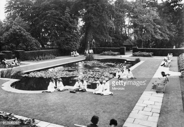 A break from work as Cadbury employees at Bournville rest up during the heatwave West Midlands Circa 1932