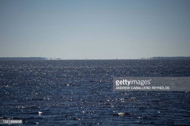 A break is seen in the St Joseph Penninsula creating a new island after it was destroyed by a storm surge as seen from Port St Joe Florida on October...