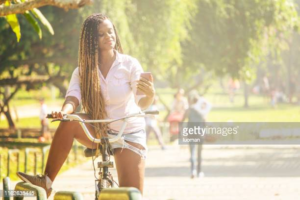 a break on the bike ride to check the messages - unripe stock pictures, royalty-free photos & images