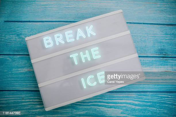 break the ice in neon lights - social gathering stock pictures, royalty-free photos & images