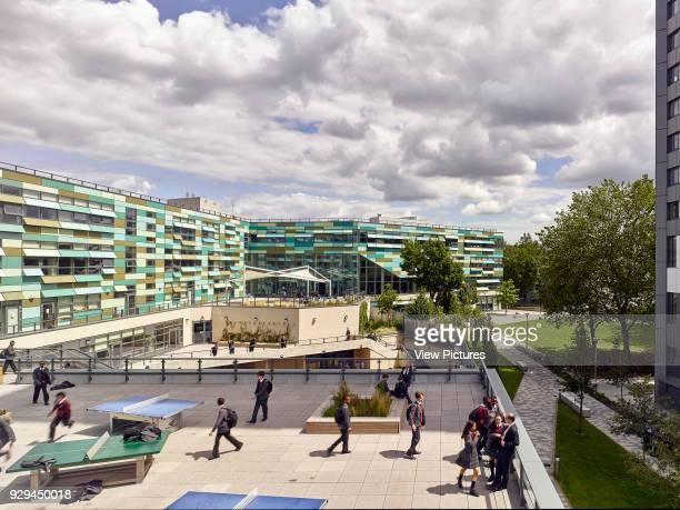 Break time looking over the play area and terraces. Kensington Aldridge Academy, London, United Kingdom. Architect: Studio E Architects, 2016.
