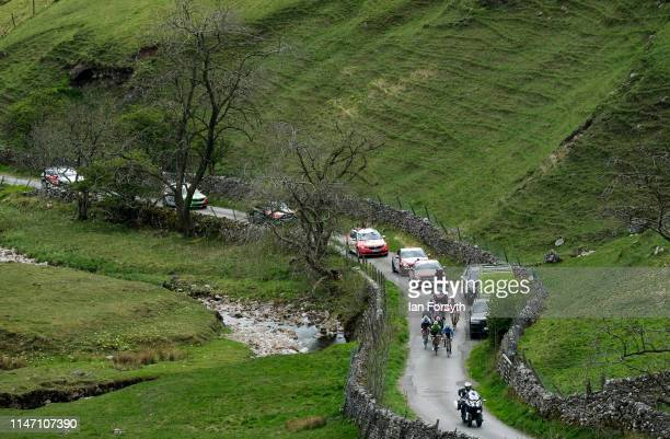 A breakaway group of riders reach the beginning of the Cote de Park Rash ascent near the village of Kettlewell in the Yorkshire Dales during the...