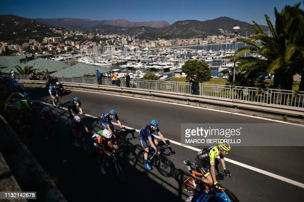 A breakaway group rides through the coastal town of Varazze during the oneday classic cycling race Milan San Remo on March 23 2019