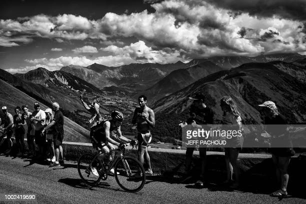 Breakaway rider Netherlands' Steven Kruijswijk rides ahead of the stage up the Col de la Croix de Fer pass during the twelfth stage of the 105th...