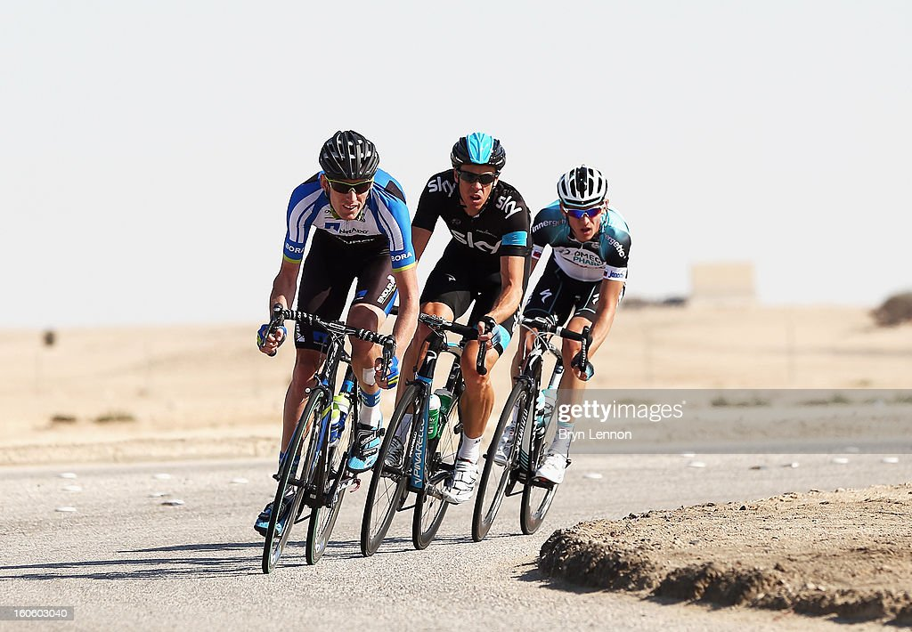 Breakaway riders Zakkari Dempster of Australia and Team Netapp-Endura leads Mathew Hayman of Australia and SKY Procycling and Martin Velits of Omega Pharma-Quick Step during stage one of the 2013 Tour of Qatar from Katara Cultural Village to Dukhan Beach on February 3, 2013 in Dukhan Beach, Qatar.