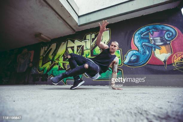 breakdance tricks - hip hop music stock pictures, royalty-free photos & images